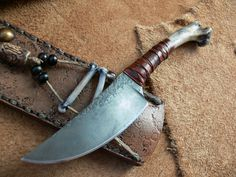 """Dervish """"Medicine Man"""" This is a """"One Of a Kind"""" by Dervish Knives and it comes with a very ornate sheath and the handle is from a Coyote Humerus, 3 to the Rawhide and 7 overall length – Now this is a """"Custom Knife"""" and it's just so cool. Swords And Daggers, Knives And Swords, Cool Knives, Knife Sheath, Knife Handles, Cold Steel, Fixed Blade Knife, Custom Knives, Chef Knife"""
