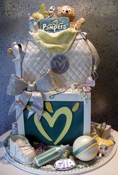 Pampers Baby Shower    Large presentation of a designer diaper bag sitting on a baby block. The shower was also a Pampers event, so logos were featured. Also, 80 , decorated & bagged cookies came along with the cake. It made quite an impression. Cory & team - Rosebud Cakes