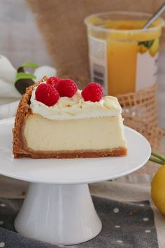 The ultimate classic BAKED LEMON CHEESECAKE… a delicious biscuit base filled with creamy, tangy lemon cheesecake and topped with whipped cream, swirls of lemon curd and fresh raspberries. Plus tips and tricks for baking the perfect cheesecake!    #baked #lemon #cheesecake #recipe #best #easy #tips #thermomix #conventional #dessert #birthday #raspberries #classic