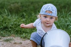 toddler with a bucket outdoor photo