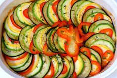 From my favorite food blogger. This ratatouille recipe does not follow the traditional prepartion, but I am sure even the late Julia Child's would approve if she could  taste it. The dollop of goat cheese is a must.