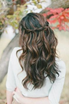 Waterfall braided hairstyle for bridesmaids.