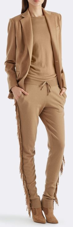 Luxury meets ease: The Ralph Lauren camel-hued jogging pant features swaying nappa lambskin fringe. A sumptuous Italian cashmere blend is woven for a tapered-leg fit, and an adjustable waistband offers supreme comfort. Complement the leisure style with a structured jacket and heeled boots.