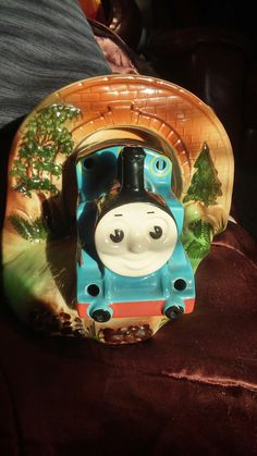 Very unusual and rare Thomas tank engine pottery childrens nightlight. Never seen anything like it before so possibley a 1960 product and was not massed produced, it has old looking BHS lighting labels on the base . the train can be seperated from the base so the 15 watt pygmy bulb can be changed