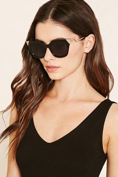A pair of cat eye sunglasses featuring pointed high polish metal corners.