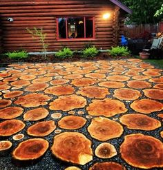 So we had to cut a very large tree down, so instead of turning it into fire wood we turned it into a patio. We love it. We used 3-4 inch slabs of western red cedar, laid on a base of rock and sand, with 1/2 inch crushed rock in between. Enjoy.: