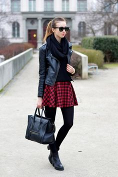 black boots, black leggings, black scarf, black leather jacket. Add the red plaid skirt to make it pop.