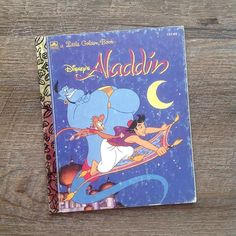 $4 plus ship. Disney's Aladdin. 1992. General wear to cover. Book is free of writing and tears. Sticker residue back cover. See detail next. #Disney #disneyaddict #disneyana #aladdin #waltdisney #vintagedisney #isnmemberitem #littlegoldenbooks #littlegoldenbook #littlegoldenbooksale #lgb