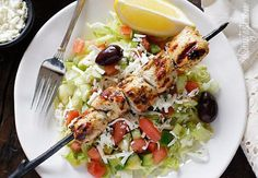 Marinated chunks of grilled chicken breast served over a bed of lettuce with feta, fresh diced tomatoes, cucumbers, green peppers, black olives, red…