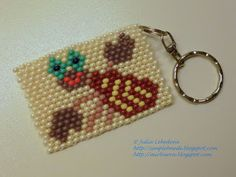 Beaded keychain with zodiac sign Cancer in brick stitch. Free detailed tutorial.