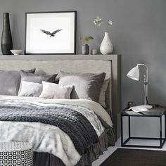 This dark grey bedroom with cosy bed linen create a relaxing space in which to unwind at the end of the day. Layer soft furnishings to create a luxurious feel