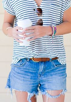 Try a cool casual vibe with some classic denim shorts and a striped tee.