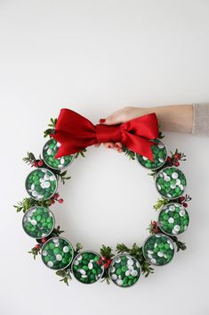 DIY Holiday Candy Favor Wreath made with tins and My M&M's via Evite and Kara's Party Ideas KarasPartyIdeas.com #mymms
