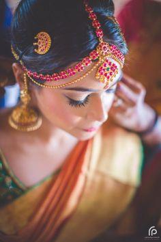 South Indian bride. Gold Indian bridal jewelry.Temple jewelry. Jhumkis. Orange silk kanchipuram sari.Braid with fresh jasmine flowers. Tamil bride. Telugu bride. Kannada bride. Hindu bride. Malayalee bride.Kerala bride.South Indian wedding.  20 Repins   6 Likes