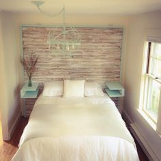 Reclaimed wood headboard and bed with floating shelves, featuring white-washed reclaimed wood and pale aqua built-in nightstands. Made by Reclaimed Goods www.reclaimedgoods.co