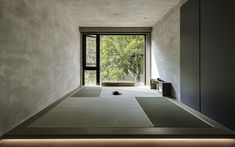 """Bedroom A """"watshitsu"""" room, which is used for meditation and tea drinking, has a fully glazed wall that looks out to the verdant trees beyond the apartment. Photo 12 of 16 in A Couple Embrace Wabi-Sabi Design to Travel Back to the Past Minimalist Architecture, Space Architecture, Minimalist Design, Architecture Wallpaper, Japanese Architecture, Home Design, Interior Design, Interior Ideas, Architecture Religieuse"""