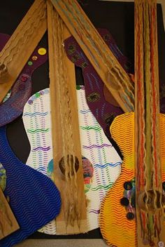 Picasso guitars- corrugated paper with cardboard necks, yarn, buttons. Rock on, little ones!