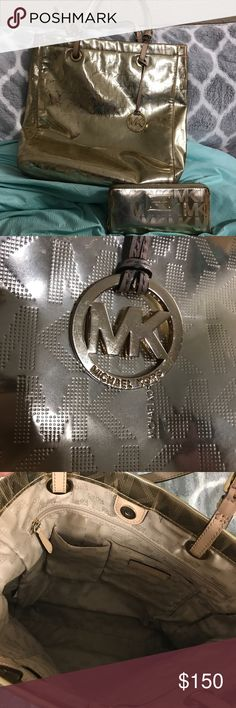 Used Michael Kors purse & wallet Used Michael Kors wallet & purse. There is a little wear on both the purse & the wallet (as seen in the pictures) but nothing that takes away the beauty of this authentic handbag & wallet. Michael Kors Bags Shoulder Bags