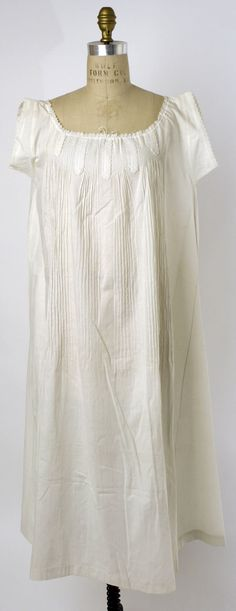 ca.1862 chemise (per Met Museum) with applied lozenges of embroidered edging between pintucks, and drawstring at neckline.