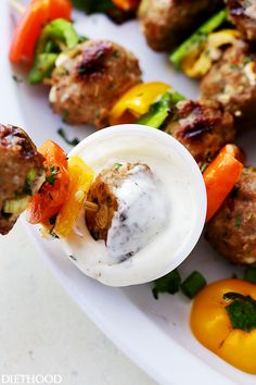 Grilled Mediterranean Turkey Meatballs Skewers - Juicy grilled turkey meatballs stuffed with olives and feta! Makes a delicious dinner, but are also great served as an appetizer, too!