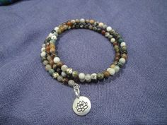 Ocean Jasper gemstone bracelt on memory wire with Lotus blossom charm. by InnerGems on Etsy