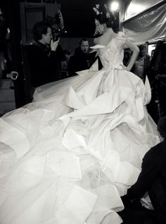 beautyandcuriosity:  SHALOM HARLOW Origami Wedding Dress by JOHN GALLIANO for DIOR COUTURE In Japan, it is commonly said that folding 1000 paper origami cranes makes a person's wish come true.
