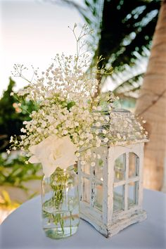 Details : White Baby breath with a white rose and white wooden lantern for the party venue (by Aquadeco & Xochitl Botanicals) - Emily & Rishi's destination wedding in Tulum