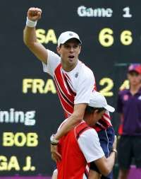 Mike and Bob Bryan of the U.S. celebrate their men's doubles tennis gold medal