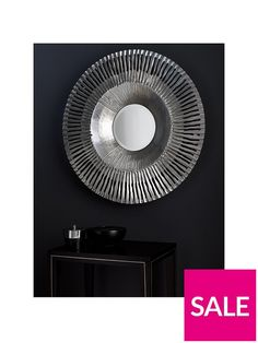 Arthouse Silver Sunbeam Mirror – 80 cm diameter A simply stunning design from home specialists Arthouse, this striking mirror sees the centre reflective panel surrounded by a sumptuous silver-toned frame, creating a simply exquisite art piece that's perfect for a feature wall. This mirror is also available in gold (see item number L44WR).Depth: 8 CMHeight: 80 CMWidth: 80 CMModern lookMetallic finishDimensions: 80 x 80 x7cmAlso available in gold L44WR