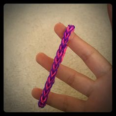 French braid rainbow loom bracelet. Handmade. For now we only have pink and purple but we can also make custom made ones too. Just Comment the colors you want. First come first serve. For now, we have about 10 of these French braids bracelets. We are also selling these for a school fundraiser so come and support! Jewelry Bracelets