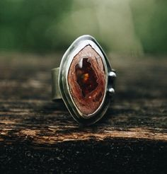 The Fire Inside... This stone pretty much jumped into my hand when I saw it. Fire opal is the stone of luck, abundance, creativity and passion; four things that have been present in my current life and I hope yours as well. Sterling silver - Fire Opal - size 6.75  This ring cannot be