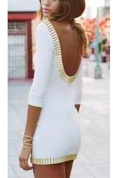 Ivory body-con dress featuring a gold bar trim and plunging scoop back. Deep scoop neckline, crop sleeves. You'll be sure to turn heads!  New double knit design for 2013!