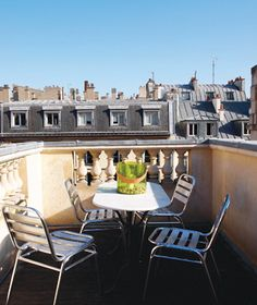 We could really get used to having our more cup of cafe au lait on this roof, at Hôtel d'Hallwyl, a home that's available for rent in the Third Arrondissement.