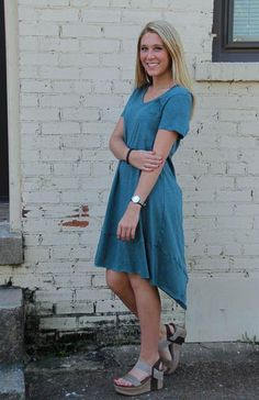 We love this Teal Hi-Low Dress and it's fun and different front triangle pocket! Perfect for those taller girls or anyone who wants to have a longer cut dress. V-neck front in a great material. Model