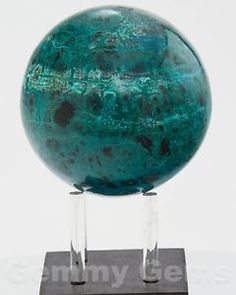 Exquisite polished Chrysocolla Sphere from Peru.  Chrysocolla is often mixed with Quartz, Selenite, Cuprite, Azurite, Malachite, Shattuckite, Hematite, Opal and Turquoise.