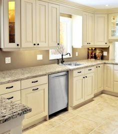 CliqStudios' Carlton kitchen cabinets in the Painted Linen. Light rails and crown molding were used to create a beautiful custom look.