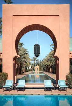Amanjena's 18 rose-toned Pavilions, six Pavilions Bassin, eight Pavilions Piscine, six two-storey Maisons and the two-bedroom Al- Hamra Maison. White Wooden Doors, Wooden Door Design, Interior Design Boards, Villa, Swimming Pool Designs, Gate Design, Architecture, Patio, House Styles