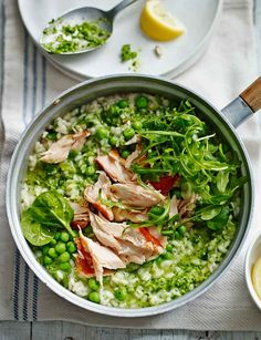 e all the stock has been absorbed into the risotto, stir in the lemon juice, the chunky pea purée and the reserved peas. Season with salt and pepper to taste. Top the risotto with the honey roast salmon flakes and add a handful of the remaining watercress, spinach and rocket leaves. Serve with lemon wedges on the sid