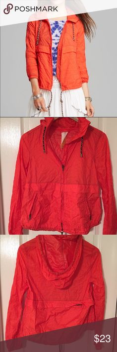 Free People Light Rain Jacket Adorable and sporty orange windbreaker from Free People! This has never been worn. The hood can be stuffed into a pocket and the whole jacket also folds up into a little pouch for convenience! Size XS, best for a 0/XS Free People Jackets & Coats