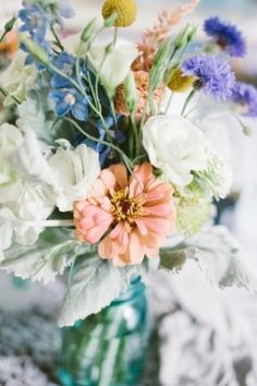 These are the colors I might end up with and some of the same flowers including white Lisianthus, blue delphinium. No pink in this arrangeme. Flower Centerpieces, Flower Decorations, Table Flowers, Beautiful Flowers, Wedding Bouquets, Wedding Flowers, Blue Delphinium, Wedding Flower Inspiration, Colour Inspiration