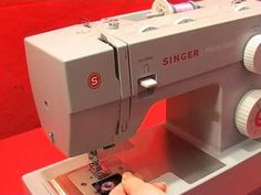 Threading your heavy duty singer sewing machine. Once I watched this video. My stitch problems went away!