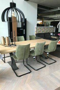 Modern dining chairs Luna upholstered in green kenia leather. Contemporary dining chairs that fit into many types of interior. Bree's New World dining chairs