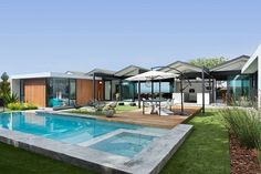 Backyard with a lavish pol deck and outdoor sitting area 1966 LA Home Designed by Pierre Koenig Turned into an Affluent Modern Escape