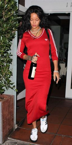 The EMPEROR of sports luxe looks, Rihanna in a long line Adidas dress with sneakers and assorted chains