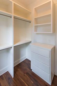 Custom walk-in closet, with double hanging racks, shelving and drawers make  for