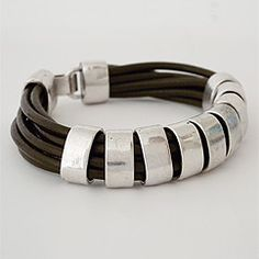 Sweet Lola jewelry. Urban chic leather bracelet with chunky silver beads. Bold. Daring. A leather bracelet to express your attitude.