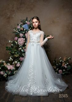 d9bdc0b487f PALOMA - FIRST COMMUNION DRESS WITH LONG SHEER SLEEVES AND EMBROIDERY  ( 420.00 ) The Paloma. Mia Bambina Boutique