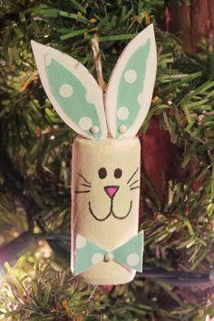 Fun, lovable and unique! This adorable set of bunny ornaments are made from recycled wine corks. Each one is hand painted and one of a kind.
