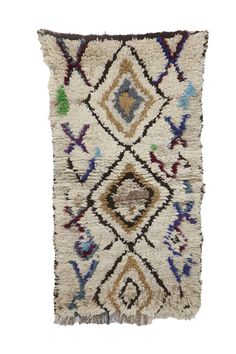 Azilal rugs are single-knotted rugs with densely decorated designs. They are usually black and white rugs, accented with bold and vibrant colors. Type of Rug: Azilal Rug Country of Origin: Morocco Region: Middle Atlas Mountains Style: Boho Chic. Mountain Style, Wool Runners, Types Of Rugs, White Rug, Weaving Techniques, Rug Cleaning, Tribal Rug, Small Rugs, Hand Knotted Rugs