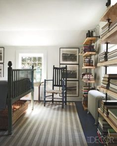 Bookcases made of plumbing pipe and reclaimed wood   James Huniford in Elle Decor